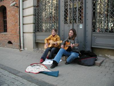 Pilies Street attracts many aspiring musicians.  They add a casual, festive atmosphere to the area.