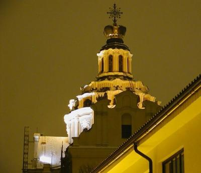 At night, the churches of central Vilnius take on a special charm in the glow of light from the adjacent streets. This is the famous steeple of St. Casimir's Church, a structure that is undergoing an extensive and quite successful renovation.